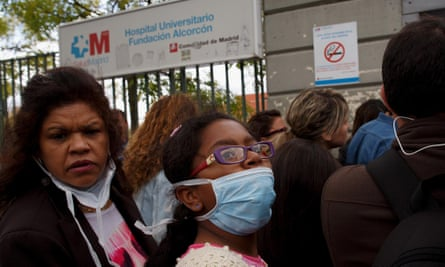People wear protective masks before they enter Hospital Fundacion Alcorcon where a Spanish nurse tested positive for the Ebola virus in Alcorcon, Spain.