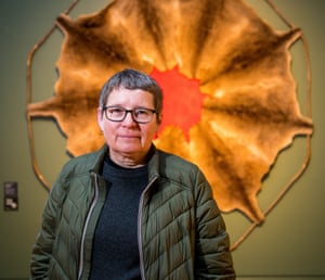 The artist Julie Gough stands in front of a piece displayed as part of Tense Past, her retrospective at the Tasmanian Museum and Art Gallery.
