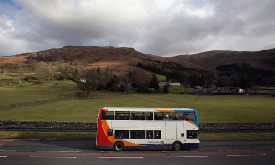 A bus travels along the road to Grasmere in the Lake District