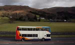 A rural bus service makes its way through the Lake District