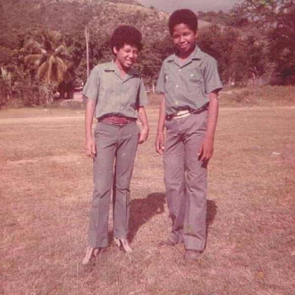 Brown with a friend at school in Jamaica, after returning in 1973