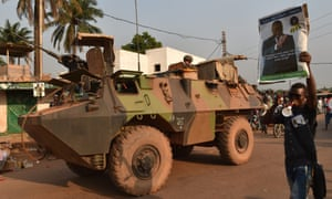 French soldiers patrol on 23 December 2015 in the PK5 Muslim district in Bangui, where the head of the Central African Republic's armed forces was shot dead on Tuesday.