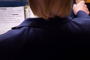 """Washington, US  President Trump looks at his notes showing the word """"Chinese"""" crossed off, during his daily briefing on Covid-19, at the White House"""