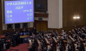 Delegates applaud as a screen showing 2,970 votes for the reelection of Chinese president Xi Jinping during a plenary session of the people's congress in Beijing on Saturday.