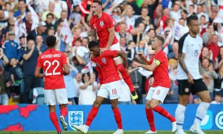 Marcus Rashford celebrates with England team-mates Phil Jones, Jordan Henderson and Trent Alexander-Arnold during Thursday's friendly match against Costa Rica at Elland Road