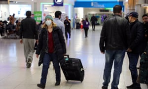A traveller wearing a face mask at Heathrow airport