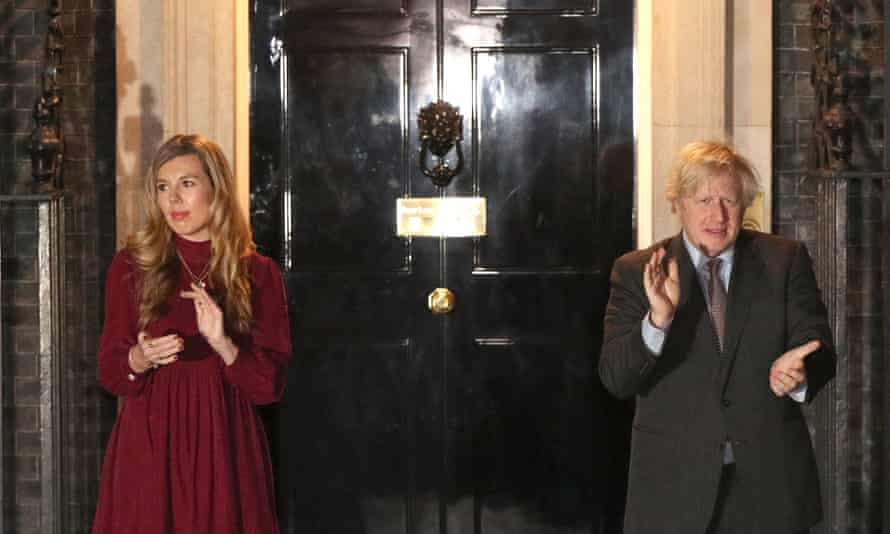 Prime Minister Boris Johnson and his partner Carrie Symonds outside 10 Downing Street join in with a nationwide clap in honour of Captain Sir Tom Moore.