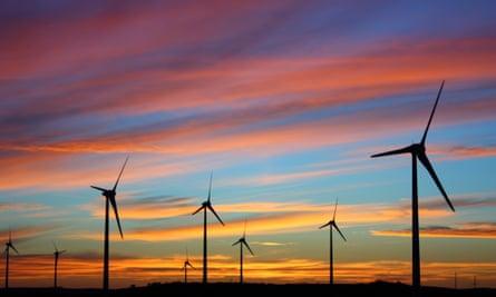 Windfarm against sunset