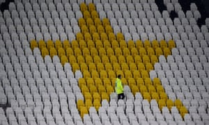 A steward inside the empty Turin stadium before a football match is played behind closed doors as the number of coronavirus cases grows around the world.