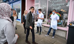 Rishi Sunak meets business people during a visit to the Isle of Bute in Scotland