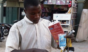 A vendor sells bags of rat poison in northern Nigeria's largest city of Kano