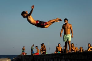 Barcelona, Spain. People jump in the water as a way of beating the heat in Catalonia. Authorities issued an orange alert for temperatures up to 40C in central, east and southern Spain