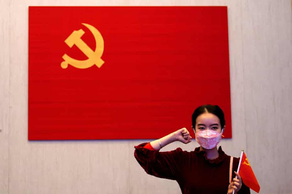 A woman poses for a picture during an event marking the 100th anniversary of the founding of the Chinese Communist party of China in Shanghai.