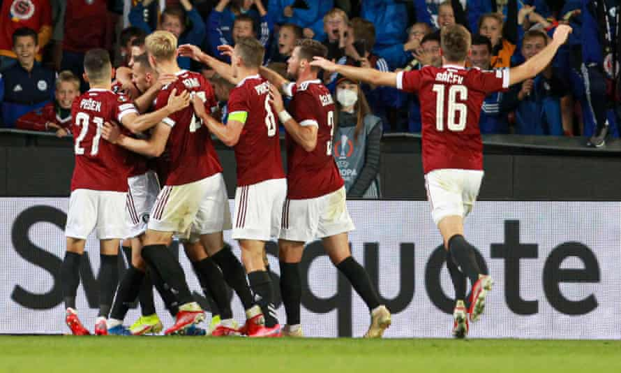 Sparta Prague's David Hancko is mobbed by his teammates after heading them in front against Rangers.