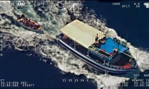 A fishing boat towing a migrants' boat towards the Italian island of Lampedusa at the weekend.