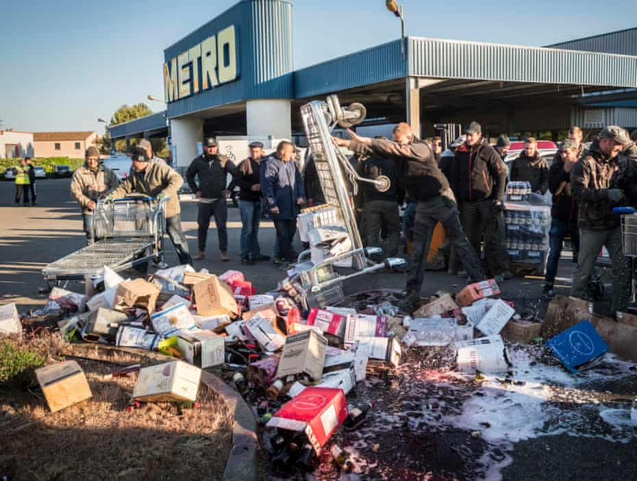 French vintners smash bottles of wine on the parking lot of a hypermarket in Caissargues, southern France.