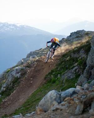 Woman riding bike in CanadaRidding mountain bike through the hilld of Whistler, BC, Canada.