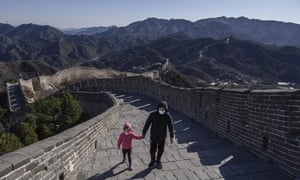 A Chinese man and his daughter wear protective masks as they walk on a nearly empty section of the Great Wall on 27 March, 2020 near Badaling in Beijing, China.