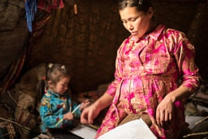 In the Nenets culture, all jobs inside the chum, including all of the house-keeping, cooking and taking care of the children and the dogs, are done by women, while men's responsibilities are with the herd. Men are prohibited from doing any of the women's work. In her free time, Lena sews and decorates boots, gloves and winter apparel using dried reindeer sinew as thread. Four-year-old Christina accompanies Lena as she goes about all of her daily chores and tasks.