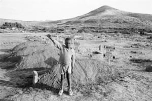 After the funeral of the Cradock Four, who were assassinated by the security police, a child gives the salute of the then banned African National Congress (ANC), Cradock. From the series Structures of Dominion and Democracy I (detail), 1985