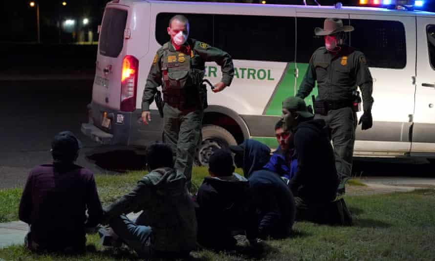 US Customs and Border Protection agents take people into custody near the Mexico border in Hidalgo, Texas.