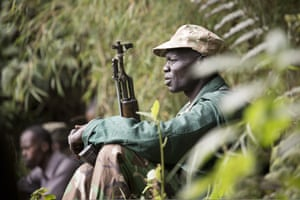 Portrait of an armed ranger on a gorilla trek in Mgahinga national park, Uganda.