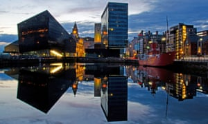Liverpool at dusk: modern buildings reflected in the still waters of Canning Dock.