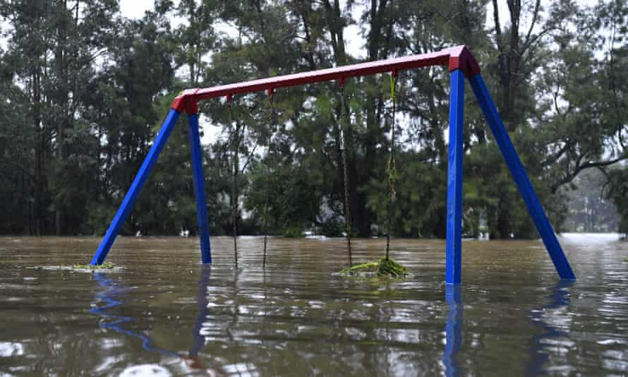A semi-submerged children's playground on the banks of the flooded Nepean River at Trench Reserve in Penrith.