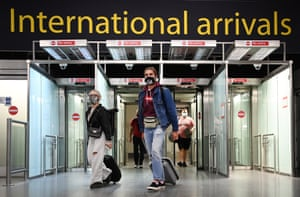 Passengers arrive at Gatwick Airport as the UK opens its borders to double jabbed citizens from the US and Europe