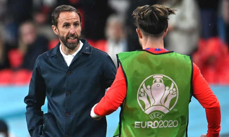 Gareth Southgate gives instructions to Jack Grealish before bringing the playmaker on against Scotland.