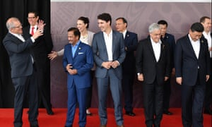 Australia's Scott Morrison poses with other world leaders, including China's Xi Jinping (right) at Apec on Sunday.
