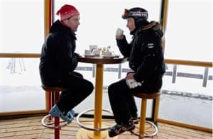 January 2010: President Dmitry Medvedev and Prime Minister Vladimir Putin enjoy a break from skiing at the Krasnaya Polyana mountain resort