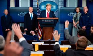 Dr Anthony Fauci, Mike Pence, Dr Deborah Birx and Adm Brett Giroir listen as Donald Trump speaks during a coronavirus taskforce briefing on 17 April.