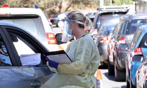 A health worker carries out Covid testing at the Joondalup drive-through clinic