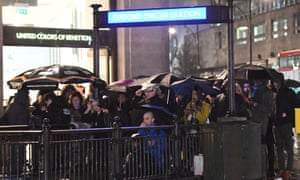 Commuters wait outside a closed entrance to Oxford Circus tube station at the conclusion of a 24-hour strike by London Underground workers