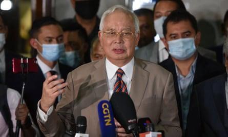 Former Malaysian Prime Minister Najib Razak speaks to the media before he leaves the court in Kuala Lumpur, Malaysia