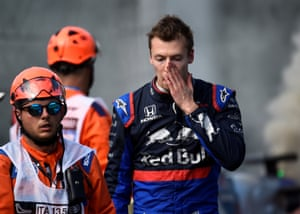 Toro Rosso's Daniil Kvyat looks dejected after retiring from the race.