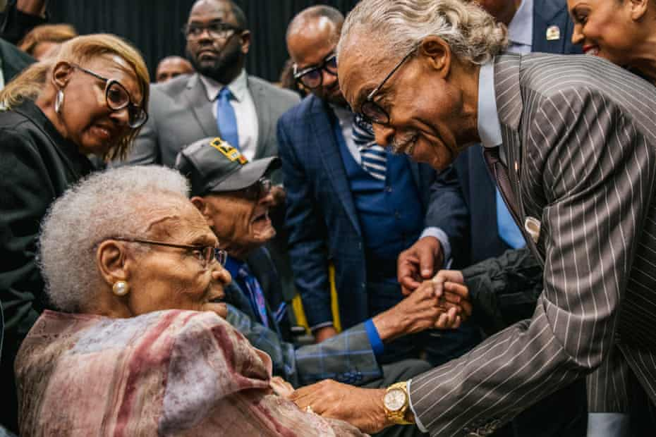 Survivors Hughes Van Ellis and Viola Fletcher are greeted by Rev Al Sharpton at a rally during commemorations of the 100th anniversary of the Tulsa race massacre.