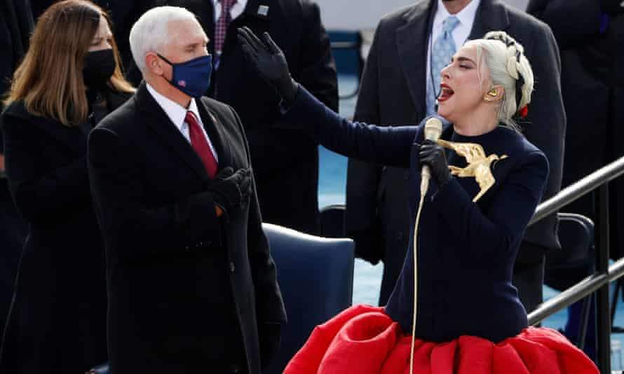 Lady Gaga sings the national anthem as Mike Pence looks on during the inauguration of Joe Biden as president of the United States.