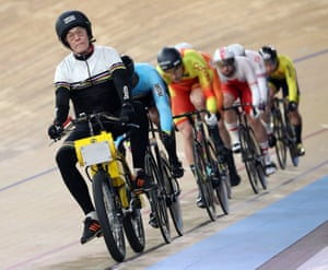 The derny paces the cyclists around the first few laps of their first round race in the men's keirin