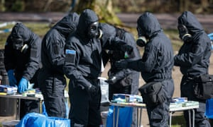 Officers in protective gear work near the location in Salisbury where Sergei Skripal and his daughter, Yulia, were discovered on 16 March.