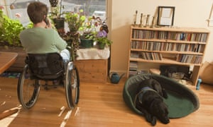 A woman with multiple sclerosis talks on the phone while in a wheelchair
