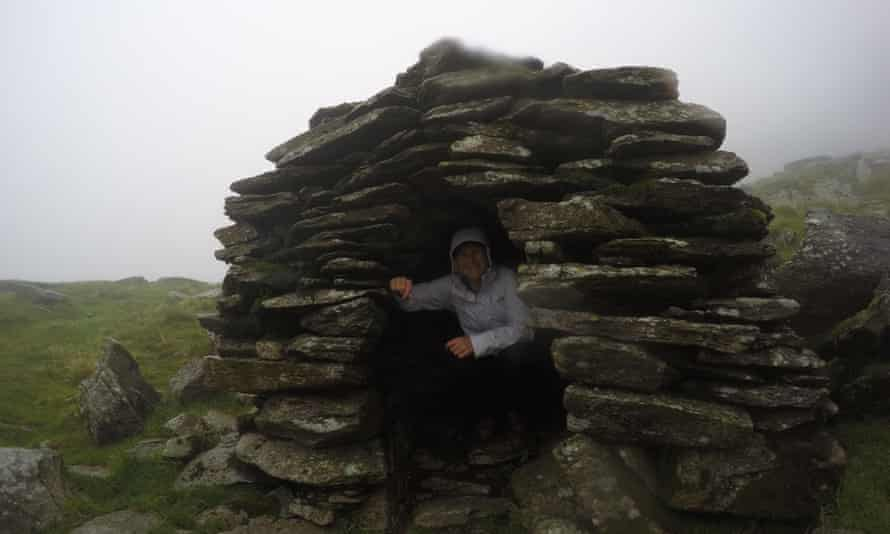 A stony shelter in a rainstorm.