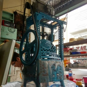 The hole-in-the-wall Min Chong Hygienic Ice Cafe still uses this cast-iron contraption to shave blocks of ice.