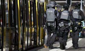 Dutch police officers walk near a tram in Utrecht