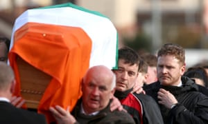 McGuinness's son Emmett follows his father's coffin to his home in Derry