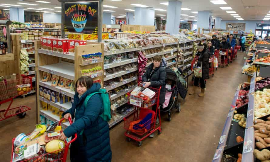 Shoppers queue in a Washington supermarket as a state of emergency is declared.