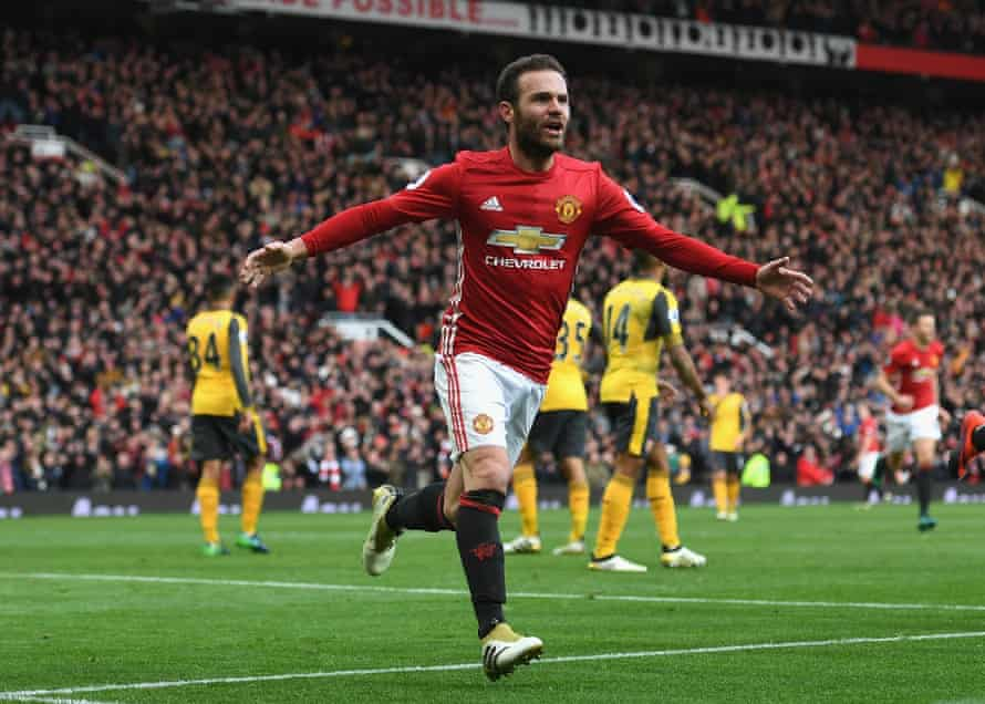 Juan Mata celebrates after putting Manchester United in front against Arsenal.