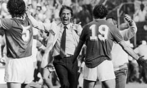 Cesare Maldini runs smiling towards Fulvio Collovati and Francesco Graziani