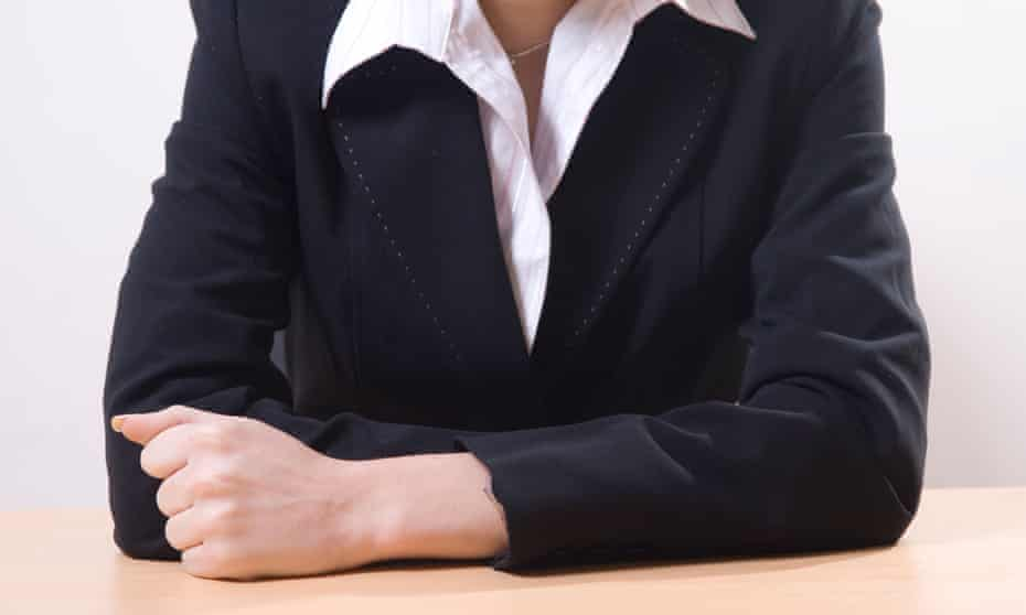 Close up of a business woman sitting in office<br>